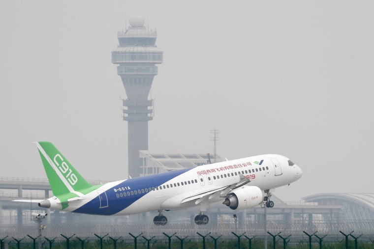 Image:China's home-grown C919 passenger jet takes off on its first flight at Shanghai Pudong International Airport in Shanghai