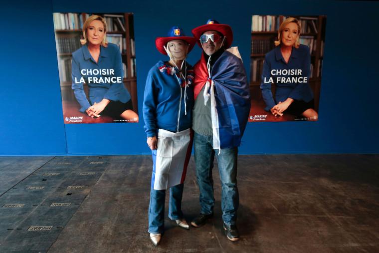 Image: People wearing Marine Le Pen masks arrive at the Parc des Expositions in Villepinte