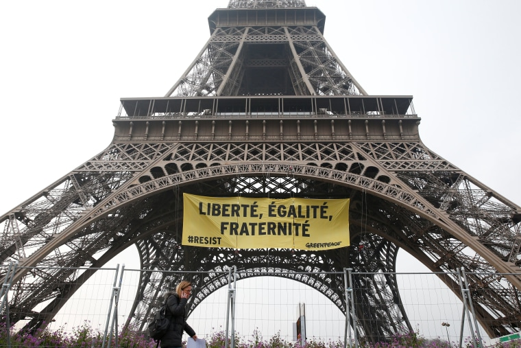 Image: Greenpeace activists unfurl a giant banner on the Eiffel Tower, in Paris.