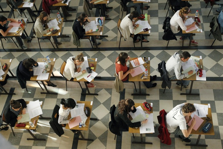 Image: Students sit for the philosophy baccalaureate exam at the French Clemenceau Lycee in Nantes