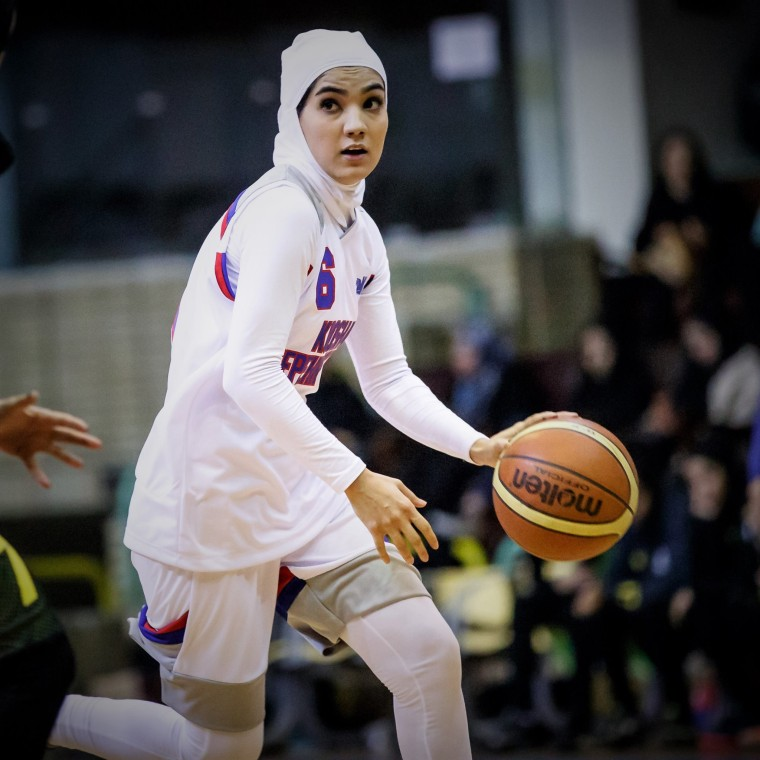 A new rule from the organization that governs basketball will allow players to wear religious headgear on the court.