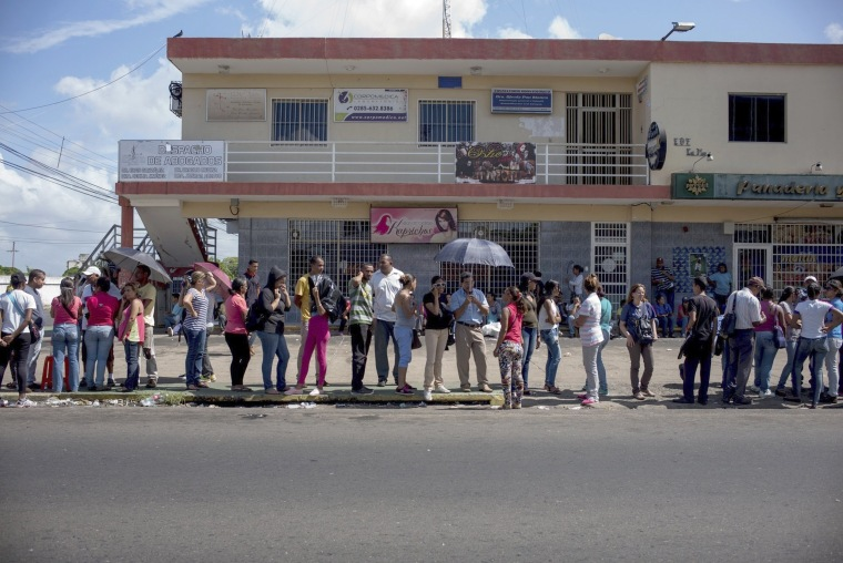 Image: People line up to buy food in one of the two groceries stores that not was looted over the weekend in Ciudad Bolivar, Venezuela, Monday, Dec. 19, 2016.