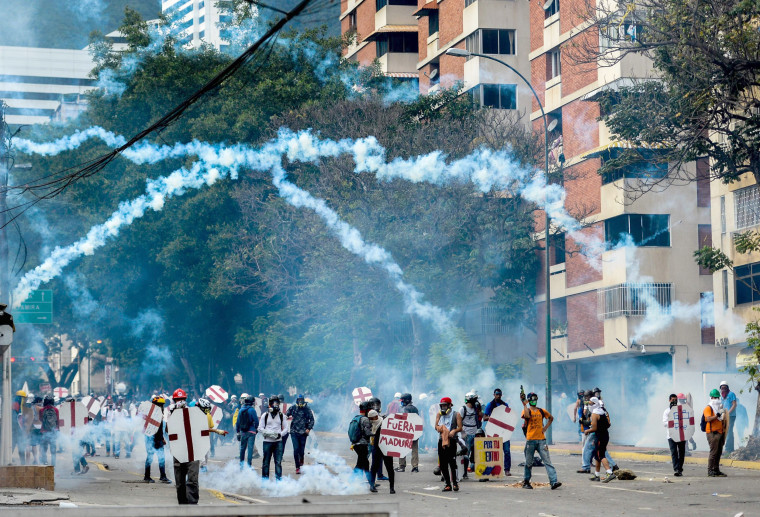 Image: Opposition demonstrators and riot police clash during a protest against President Maduro in Caracas on May 3, 2017.