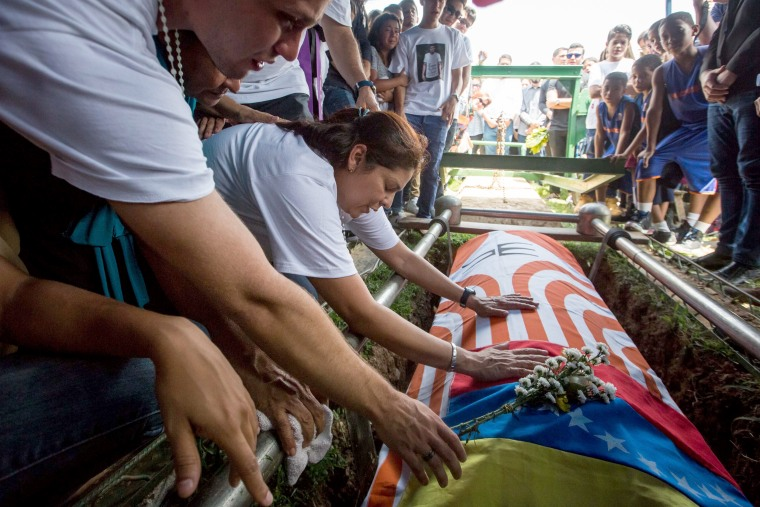 Image: Friends and family of Juan Pablo Pernalete Llovera mourn his death at a funeral in Caracas, Venezuela, April 29, 2017.