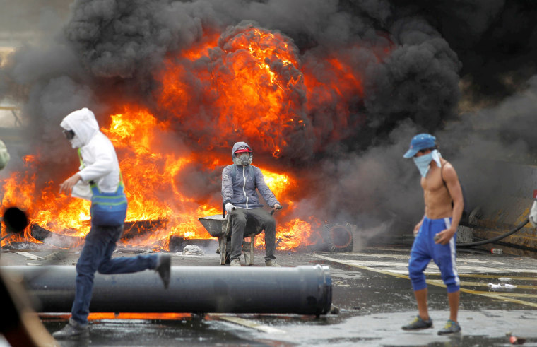 Image: Demonstrators build a fire barricade on a street during a rally against Venezuela's President Nicolas Maduro in Caracas, Venezuela, April 24, 2017.