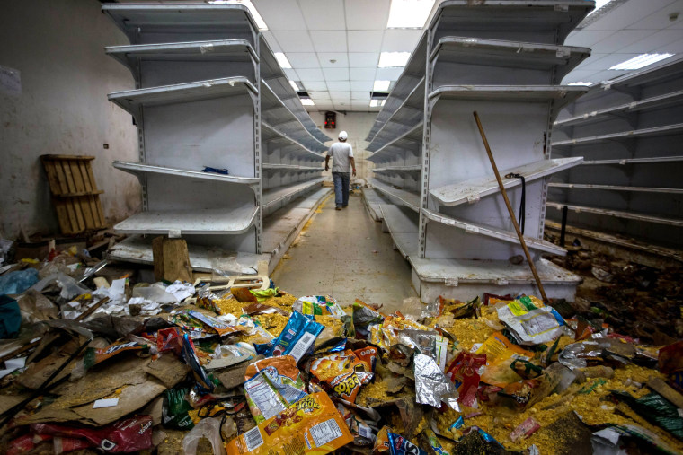 Image: A man walks down the aisle of a destroyed grocery store in Caracas, Venezuela, April 21, 2017.