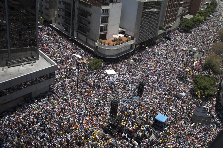 Image: Thousands of demonstrators protesting against Maduro's government march in Caracas on April 8, 2017.