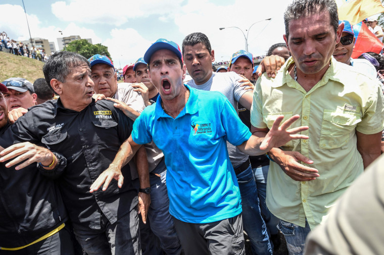 Image: Venezuelan opposition leader and former presidential candidate Henrique Capriles takes part in a protest on April 6, 2017 in Caracas.