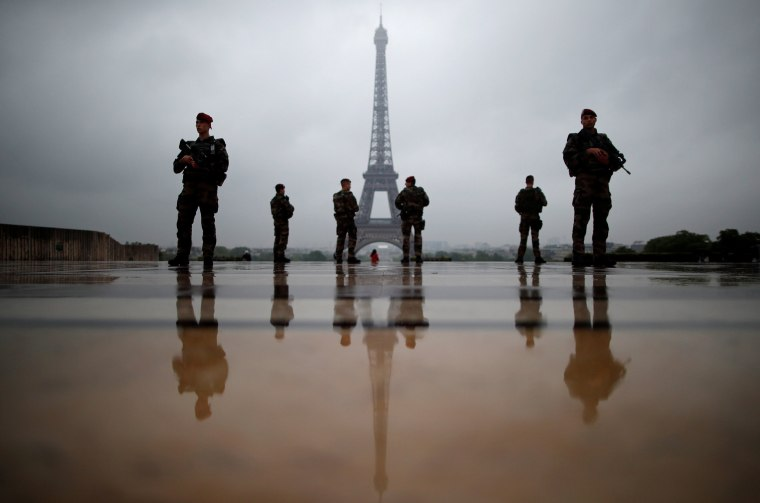 """Image: French soldiers patrol near the Eiffel Tower as part of the """"Sentinelle"""" security plan in Paris"""