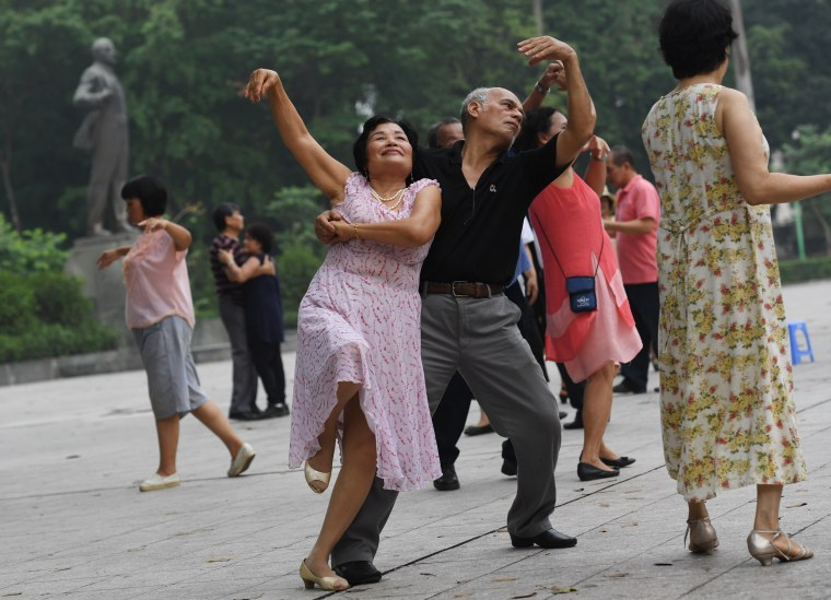 Image: Members of a dance club, mostly with retired people, dance at Lenin park in downtown Hanoi