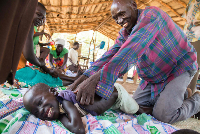 Image: A refugee child from Sudan with disabilities is massaged