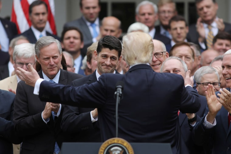 Image: U.S. President Trump turns to Speaker Ryan as he gathers with Republican House members after healthcare bill vote at the White House in Washington