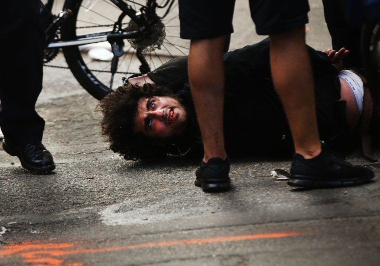 Image: A protester is arrested as he marches with others in New York