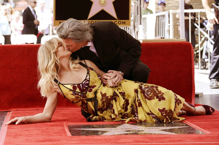Image: Goldie Hawn and Kurt Russell kiss at a ceremony honoring the couple each with stars on the Hollywood Walk of Fame