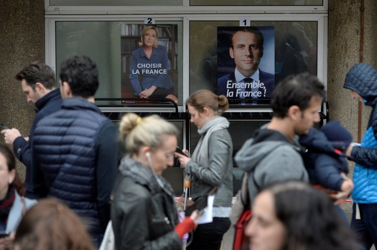 Image: French voters registered overseas line up outside the Lycee Francais Charles de Gaulle in London to vote Sunday.