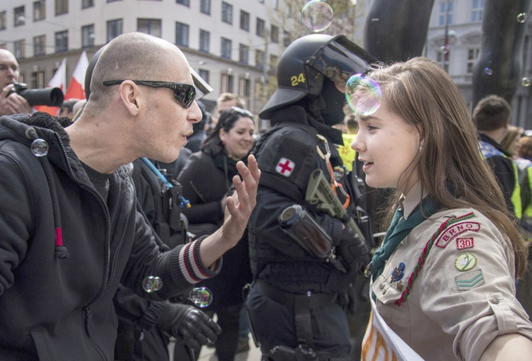 Image: In this picture taken in Brno, Czech Republic, May 1, 2017, 16-year-old Lucie Myslikova talks to a protester at a right wing demonstration.