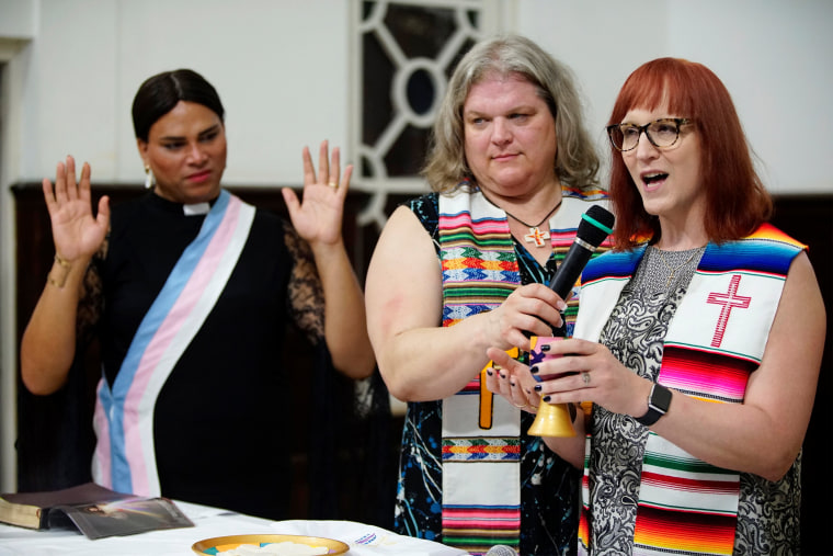 Image: Trans pastors Cindy Bourgeois from Canada (C) and Alexya Salvador from Brazil listen to trans Baptist reverend Allyson Robinson from the U.S. during a mass in Matanza