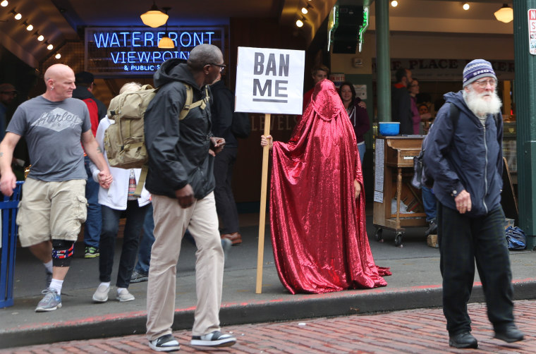 """The """"Red Chador"""" standing in Seattle after the November elections."""