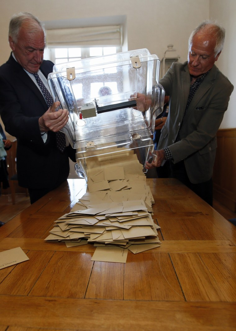 Image: A ballot box is emptied in Saint-Jean-de-Luz, France