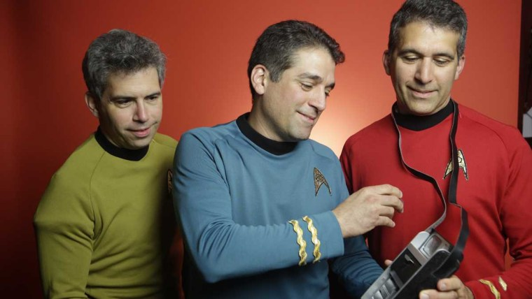 Brothers George, Basil and Gus Harris examine prop tricorders from the Star Trek series.
