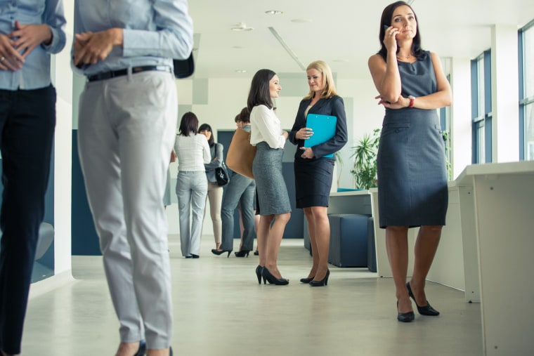 Image: Group of businesswomen in an office corridor