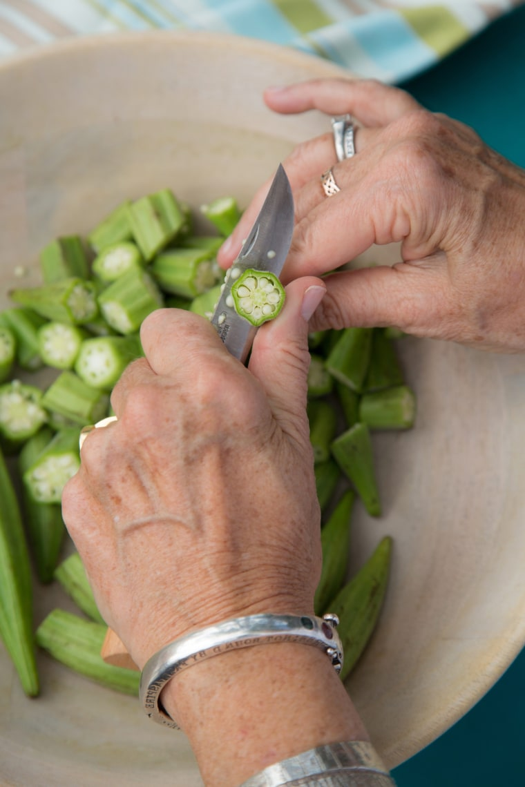 Chef and author Lucy Buffett chopping okra