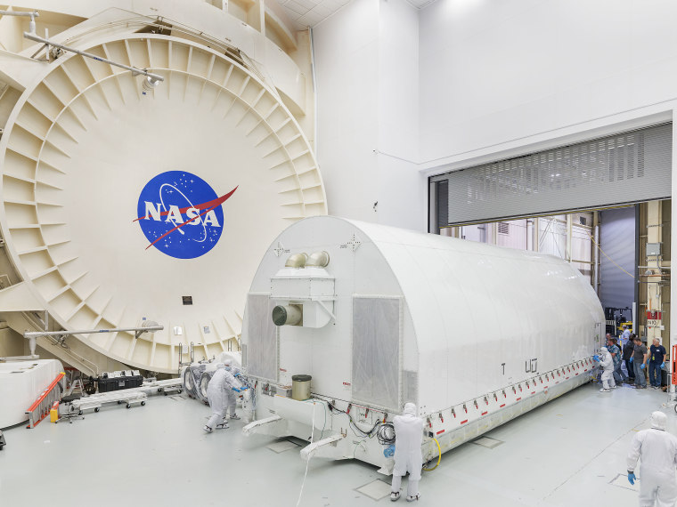 NASA personnel transfer the James Webb Space Telescope to a clean room at Johnson Space Center. There, the full optical system will go into a vacuum chamber that reaches extremely low temperatures and was originally used to test the Apollo spacecraft.