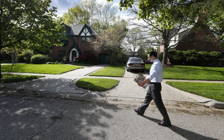 Image: Heath Mello walks through the Dundee neighborhood while canvassing for votes