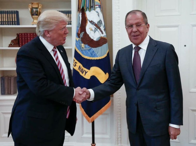 Image: Donald Trump shakes hands with Russia's Foreign Minister Sergei Lavrov