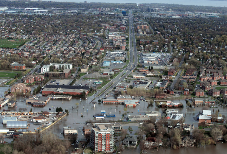 Image: An overhead view showing St Jean Blvd.,  in the flooded residential neighbourhood in Pierrefonds, Quebec, Canada