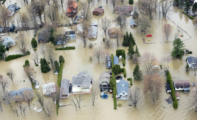 Image: An aerial photo shows flooded homes in Rigaud, Quebec