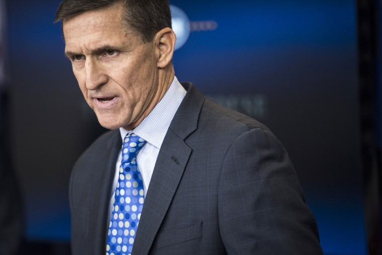 Image: Flynn speaks at a White House news briefing in February
