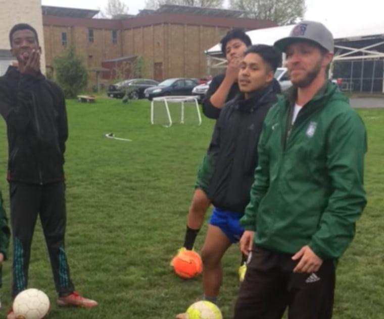 Coach Kaig Lightner with his soccer team