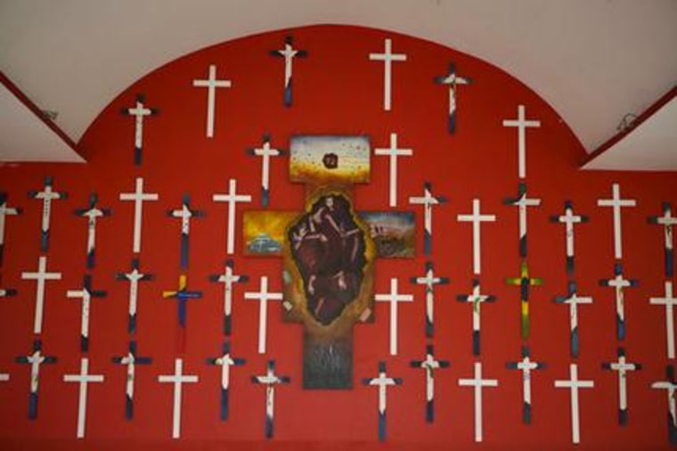 In this Dec. 6, 2016 file photo, crosses representing 72 migrants massacred in 2010 adorn the chapel at La 72, a migrant shelter in Tenosique, Tabasco state, Mexico.