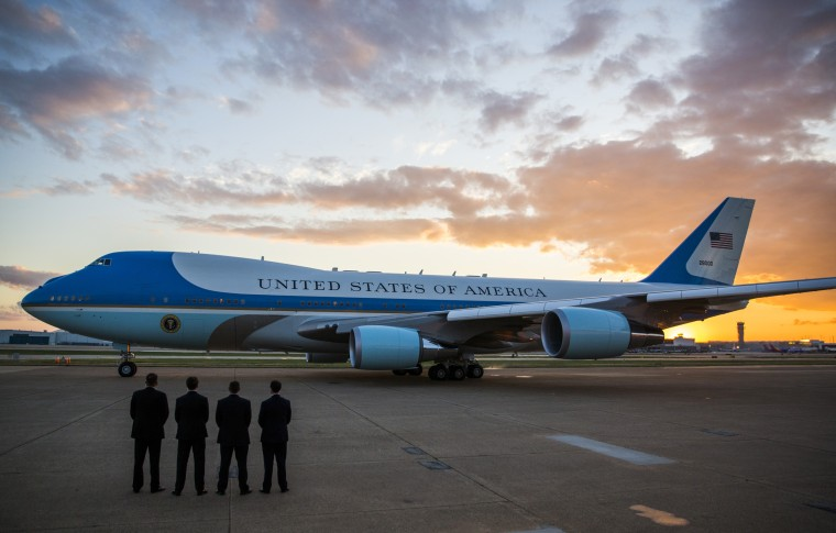 Image:  Secret Service agents stand by as Air Force One departs from Dallas