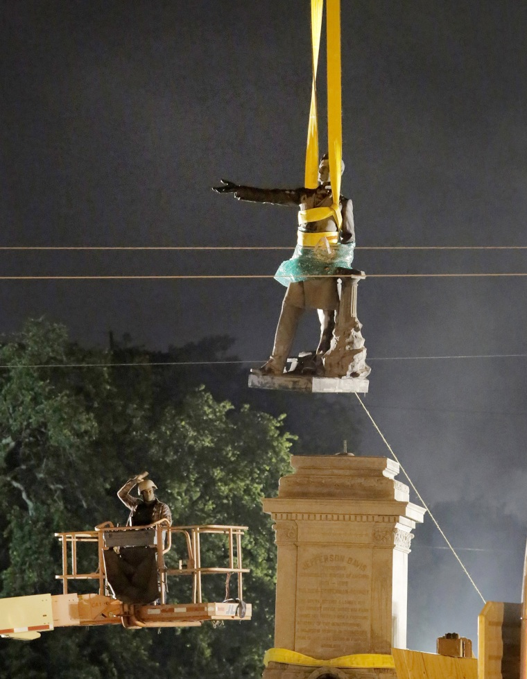 Image: The statue of Confederate President Jefferson Davis is removed in the early morning hours in New Orleans