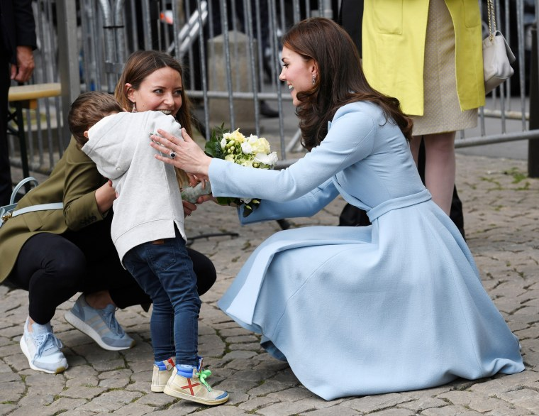 Image: A young boy reacts after he handed a bouquet of flowers to Britain's Catherine, the Duchess of Cambridge in Luxembourg