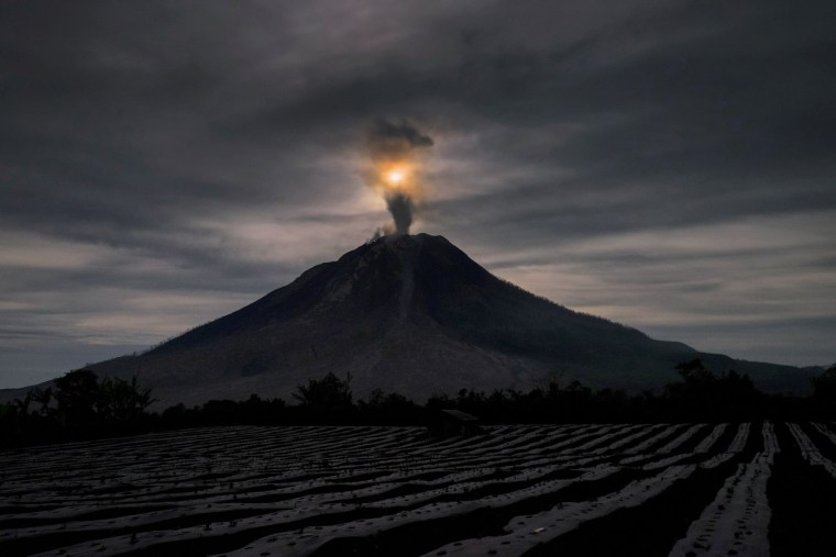 Image: Mount Sinabung volcano spews thick volcanic ash