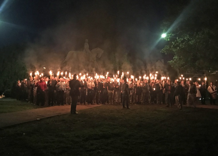 Demonstrators carrying torches protest the removal of a Robert E. Lee statue in Charlottesville, Virginia, on May 13.