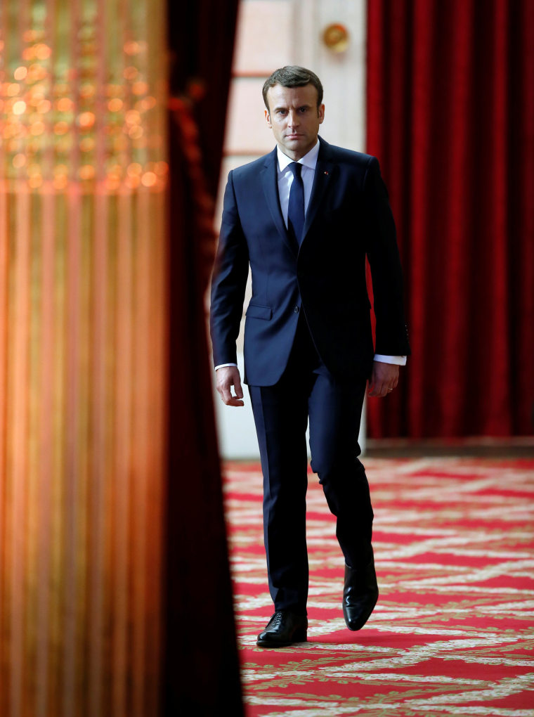 Image: French President Emmanuel Macron arrives to deliver a speech during his inauguration at the handover ceremony at the Elysee Palace in Paris