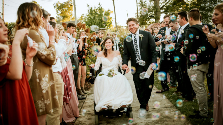 Quadriplegic bride weds her high school sweetheart