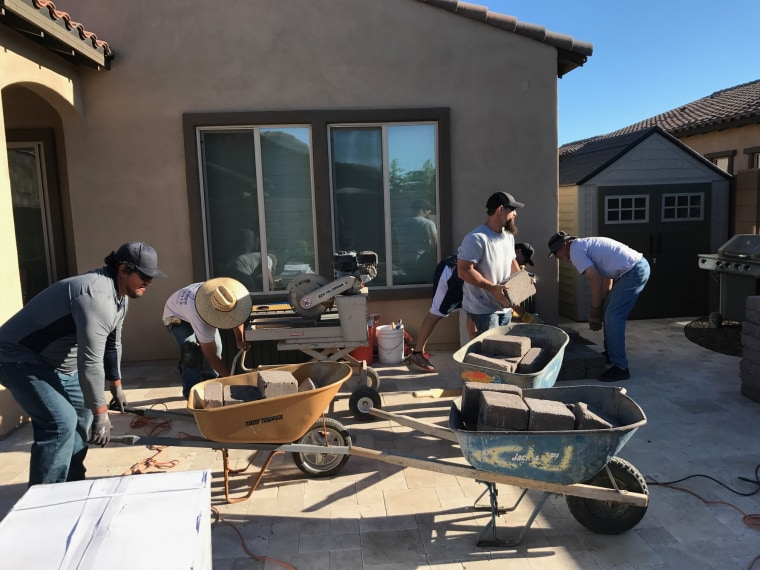 Craftsmen, neighbors spruce up family's property while they tend to son with cancerous brain tumor