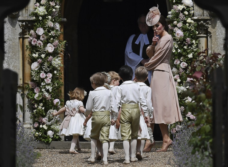 Duchess Kate tells the kiddos to hush as they walk into sister Pippa Middleton's wedding in May 2017.