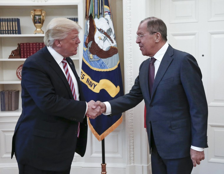 Image: President Donald Trump shakes hands with Russian Foreign Minister Sergey Lavrov