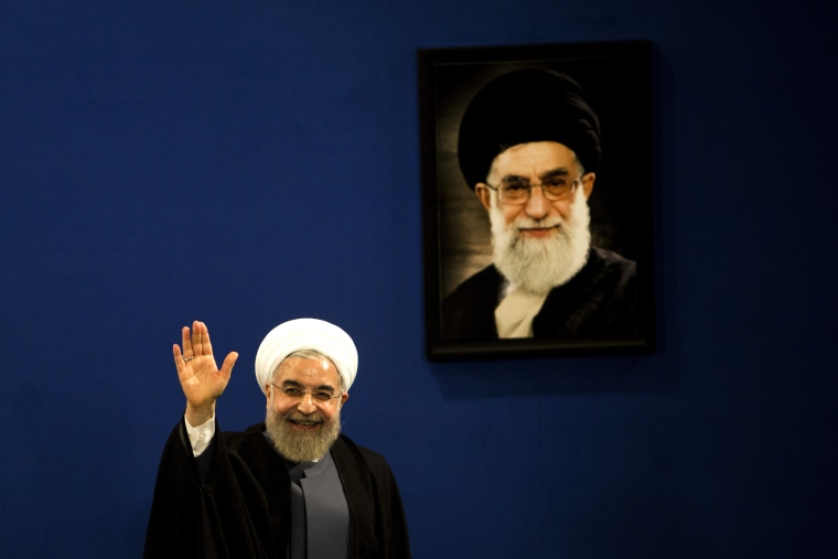 Image: Iranian President Hassan Rouhani next to a portrait of Ayatollah Ali Khamenei in 2015