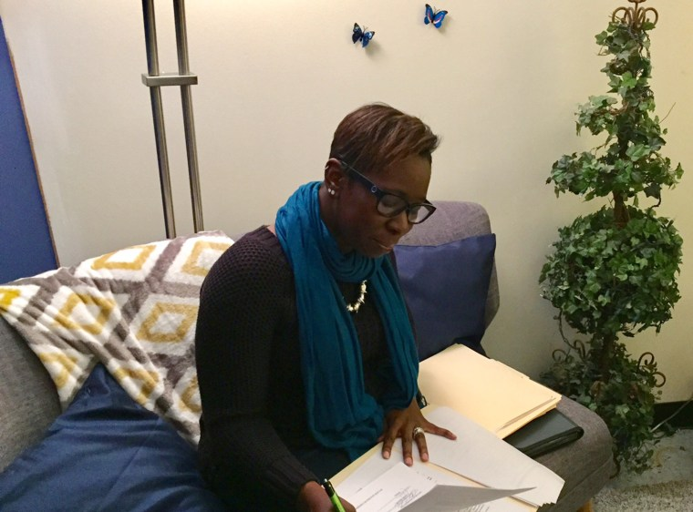 Image: Rape Counselor DeVona Alleyne works in her office on the west side of Chicago