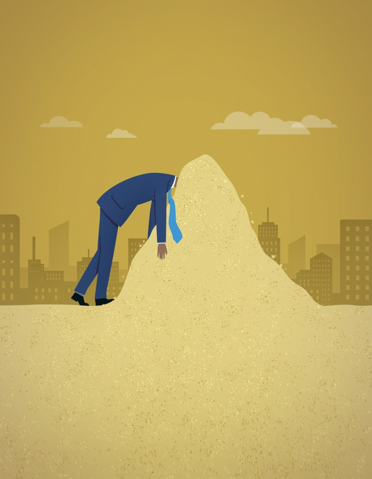 Image: Businessman burying head in the sand