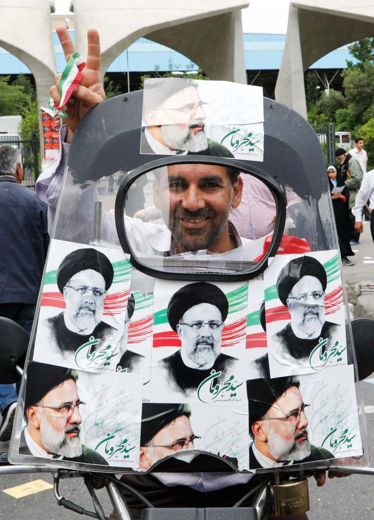 Image: A supporter of Ebrahim Rasi on a motorcycle