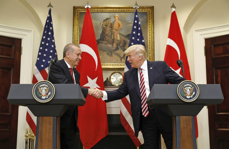 Image: Turkey's President Erdogan shakes hands with U.S. President Trump in the Roosevelt Room of the White House in Washington