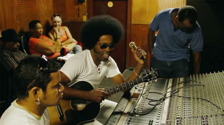 Alex Cuba at mixing board